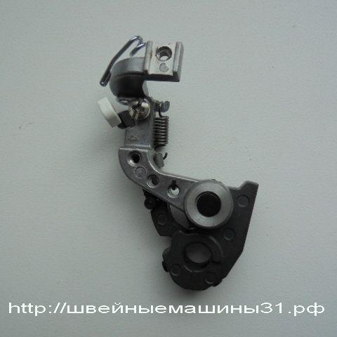 Крепление петлителя цепного стежка JUKI 735     цена 2900 руб.